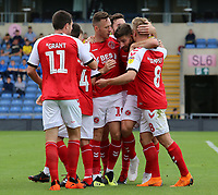 Fleetwood Town's Ched Evans is mobbed after scoring his side's first goal <br /> <br /> Photographer David Shipman/CameraSport<br /> <br /> The EFL Sky Bet League One - Oxford United v Fleetwood Town - Saturday August 11th 2018 - Kassam Stadium - Oxford<br /> <br /> World Copyright &copy; 2018 CameraSport. All rights reserved. 43 Linden Ave. Countesthorpe. Leicester. England. LE8 5PG - Tel: +44 (0) 116 277 4147 - admin@camerasport.com - www.camerasport.com