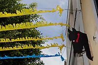 "Spain. Balearic Islands. Minorca (Menorca). Mahon. Horse head used as decoration during the traditional summer festival of ""Festes de la Mare de Déu de Gràcia"". Colorful festive bunting across street. The Menorquín is a breed of horse indigenous to the island and is closely associated with the doma menorquina style of riding. The riders and their horses parade through the streets, and these magnificent and remarkably calm horses rear up on their hind-legs to the delight of the crowd. Some 150 riders participate in the festival in Mahón. Riders pass through the crowds, executing caracoles and repeatedly performing the bot. Maó (in Catalan) and Mahón (in Spanish), written in English as Mahon, is a municipality, the capital city of the island of Menorca, and seat of the Island Council of Menorca. The city is located on the eastern coast of the island, which is part of the autonomous community of the Balearic. In Spain, an autonomous community is a first-level political and administrative division, created in accordance with the Spanish constitution of 1978, with the aim of guaranteeing limited autonomy of the nationalities and regions that make up Spain. 12.09.2019 © 2019 Didier Ruef"