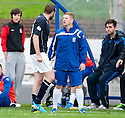 Dundee's Craig Beattie and Cowdenbeath's Marc McKenzie have a go at each other in the dug out.