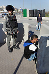 Israeli border policemen arrest a Palestinian man at the Beit Ainun junction near the West Bank city of Hebron, on April 4, 2016. The man reportedly was arrested within the usual security measures taken in the region by the Israeli forces. Photo by Wisam Hashlamoun