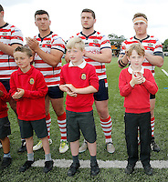 Oldham Roughyeds with mascots during the Kingstone Press Championship game between London Broncos and Oldham Roughyeds at Ealing Trailfinders, Ealing, on Sun June 19, 2016