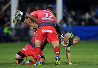 Jonathan Joseph of Bath Rugby is upended in a tackle by Xavier Chiocci of Toulon. European Rugby Champions Cup match, between Bath Rugby and RC Toulon on January 23, 2016 at the Recreation Ground in Bath, England. Photo by: Patrick Khachfe / Onside Images