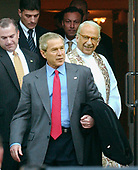 Washington, D.C. - February 19, 2006 -- United States President George W. Bush and first lady Laura Bush leave St. Johns Church in Washington, D.C. following Sunday morning services on February 19, 2006.   Reverend Spencer Rice, right, escorts the first couple from the church.<br /> Credit: Ron Sachs / CNP