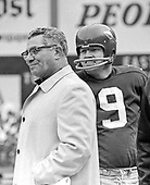 Washington Redskins quarterback Sonny Jurgensen (9), right, and head coach Vince Lombardi, left, on the sidelines during the game against the Los Angeles Rams at RFK Stadium in Washington, D.C. on November 30, 1969.  The Redskins lost the game 24 - 13.<br />
