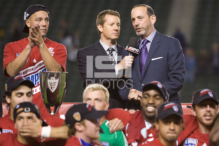 MLS Commissioner Don Garber (r) prepares to give the MLS Western Conference Championship trophy to FC Dallas Captain Daniel Hernandez (l). FC Dallas defeated the LA Galaxy 3-0 to win the Western Division 2010 MLS Championship at Home Depot Center stadium in Carson, California on Sunday November 14, 2010.