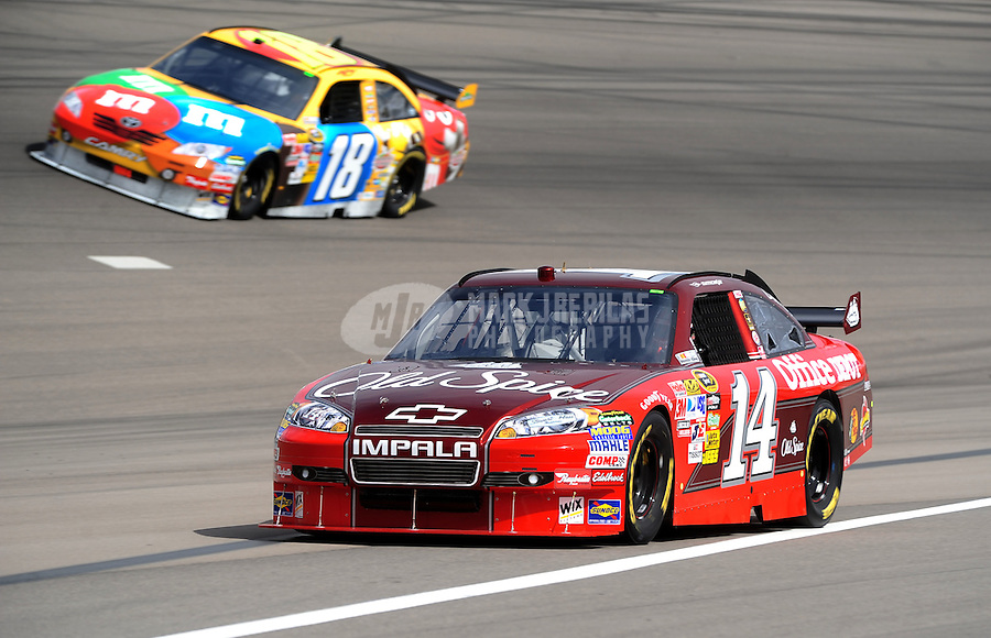 Feb. 26, 2010; Las Vegas, NV, USA; NASCAR Sprint Cup Series driver Tony Stewart (14) and Kyle Busch during practice for the Shelby American at Las Vegas Motor Speedway. Mandatory Credit: Mark J. Rebilas-