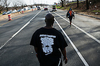 A Man walks during the March4justice in North Brunswick, New Jersey 04.13.2015. The Action it's a nine day march from NYC to the U.S. Capitol in Washington DC. Kena Betancur/VIEWpress.