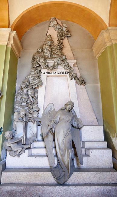 Picture and image of the stone sculpture of an angel guarding the pyramid shaped tomb with some Egyptian symbols of death which increases the sense of mystery. Tomb Gorlero sculptor E. Sclavi 1892. Section A, no 24, The monumental tombs of the Staglieno Monumental Cemetery, Genoa, Italy
