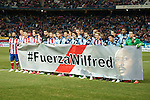Atletico de Madrid´s and Rayo Vallecano´s players make a tribute to Wilfred during 2014-15 La Liga match between Atletico de Madrid and Rayo Vallecano at Vicente Calderon stadium in Madrid, Spain. January 24, 2015. (ALTERPHOTOS/Luis Fernandez)