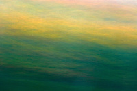 Crashing waves over shorline rocks st dusk<br /> Horseshoe Lake<br /> Ontario<br /> Canada