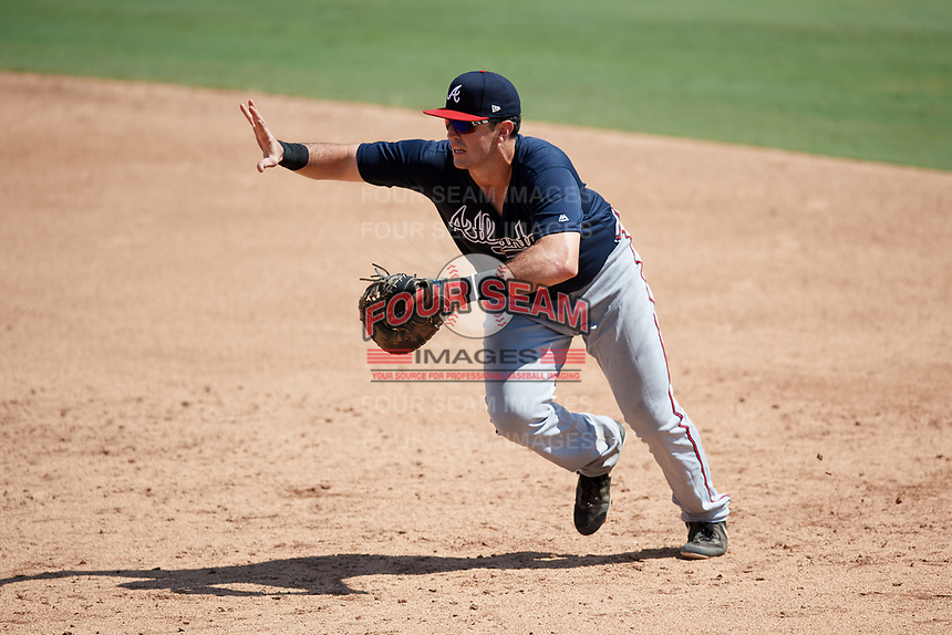 Atlanta Braves first baseman Austin Bush (59) calls off the pitcher after fielding a ground ball during an Instructional League game against the Baltimore Orioles on September 25, 2017 at Ed Smith Stadium in Sarasota, Florida.  (Mike Janes/Four Seam Images)