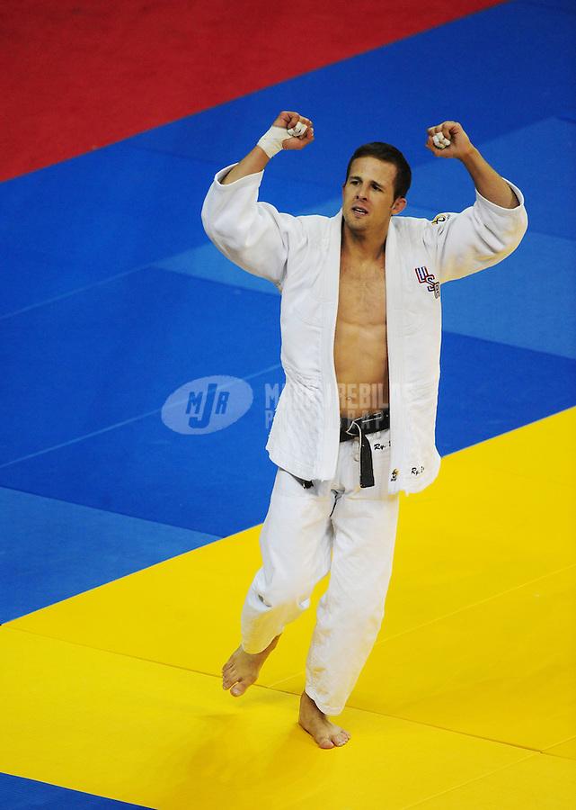 Jun 14, 2008; Las Vegas, NV, USA; Ryan Reser (white) celebrates after defeating Chuck Jefferson during the final round of their championship match in the Mens 73 kg Judo match at Thomas & Mack Center. Mandatory Credit: Mark J. Rebilas-