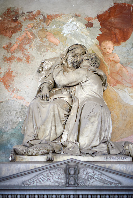 Picture and image of the stone sculpture of a husband and wife hugging.  Sculpted by G B Cevasco 1871. The monumental tombs of the Staglieno Monumental Cemetery, Genoa, Italy