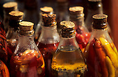 Porto Seguro, Bahia State, Brazil. Bottles of oil flavoured with different types of chili.