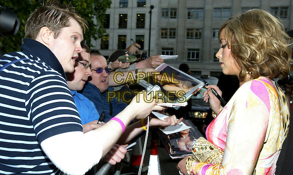 CHARLOTTE CHURCH.At the Glamour Women of the Year Awards, .Berkeley Square, London, June 7th 2005..half length signing autographs fans.Ref: JL.www.capitalpictures.com.sales@capitalpictures.com.©Jonathan Larkin/Capital Pictures.