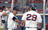 Boston Red Sox Rick Burleson with Phil Plantier (29) during spring training circa 1992 at Chain of Lakes Park in Winter Haven, Florida.  (MJA/Four Seam Images)