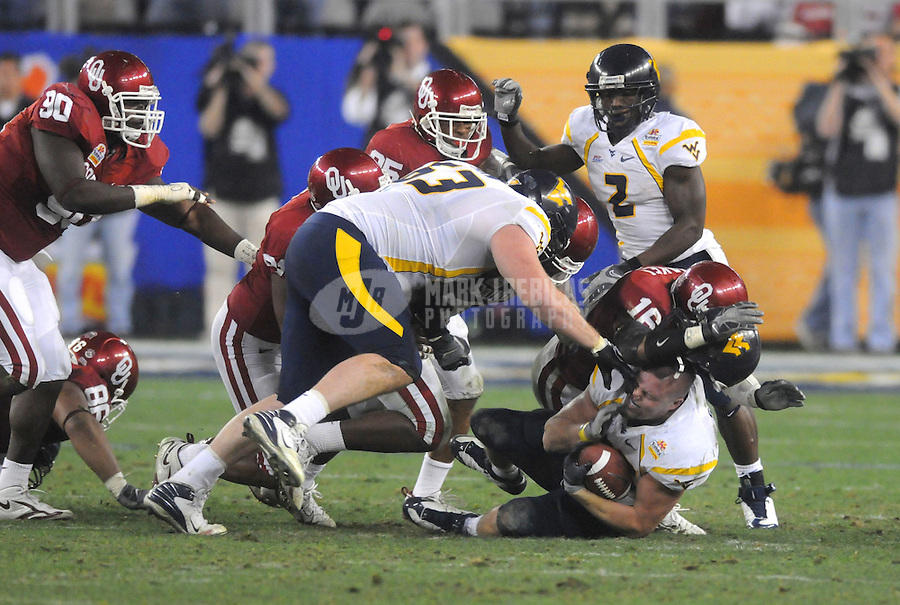 Jan 2, 2008; Glendale, AZ, USA; West Virginia Mountaineers running back Owen Schmitt (35) has his helmet knocked off during the second quarter against the Oklahoma Sooners during the Fiesta Bowl at University of Phoenix Stadium. Mandatory Credit: Mark J. Rebilas-US PRESSWIRE