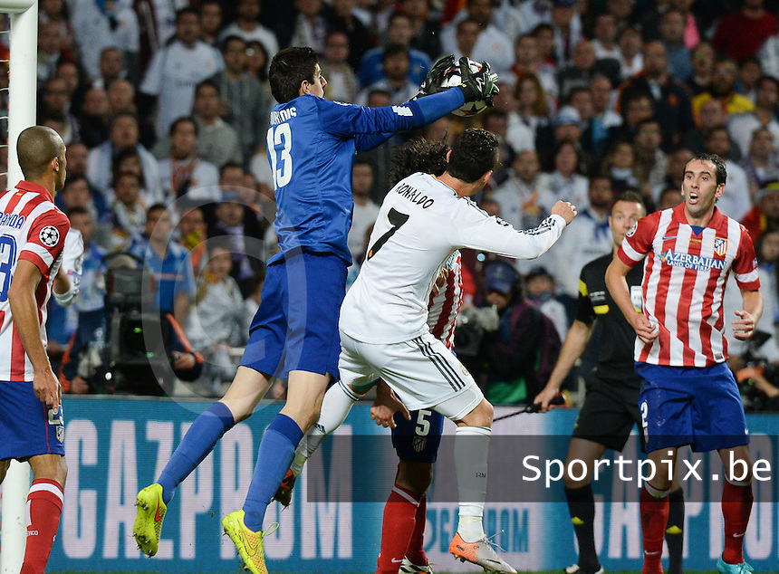 20140524 - LISBON , PORTUGAL : Atletico's goalkeeper Thibaut Courtois pictured taking the ball above the head of Real's Cristiano Ronaldo during soccer match between Real Madrid CF and Club Atletico de Madrid in the UEFA Champions League Final on Saturday 24 May 2014 in Estadio Da Luz in Lisbon .  PHOTO DAVID CATRY
