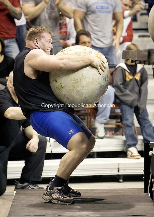 UNCASVILLE, CT. 20 January 2008-012008SV18--Derek Poundstone of Waterbury lifts stones onto a platform during an event of the World Strong Man Super Series competition at Mohegan Sun Arena in Uncasville on Saturday. Poundstone won the event.<br /> Steven Valenti Republican-American
