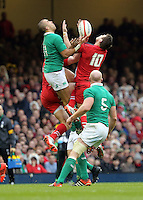 Pictured L-R: Simon Zebo of Ireland battles against Dan Biggar of Wales to catch the ball  Saturday 14 March 2015<br />