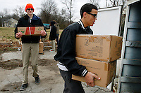 NWA Media/DAVID GOTTSCHALK - 12/17/14 - Stevin Martinez, right, 16, and Noah Parker, 14, both students at Teen Challenge Adventure Ranch in Morrow, load a trailer with food items Wednesday at LifeSource in Fayetteville. The students volunteer monthly to help unload food items from the Arkansas Rice Depot food bank in Little Rock and distribute the food to 20 different food pantries in the Northwest Arkansas region.