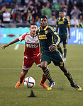 Jun 6, 2015; Portland, OR, USA; Portland Timbers midfielder/forward Dairon Asprilla (11) goes after a ball with New England Revolution midfielder Kelyn Rowe (11)during the second half of the game at Providence Park. The Timbers won the game 2-0. Mandatory Credit: Steve Dykes-USA TODAY Sports