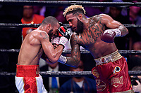 """Fairfax, VA - May 11, 2019: Jarrett """"Swift"""" Hurd lands a punch inside during Jr. Middleweight title fight at Eagle Bank Arena in Fairfax, VA. Julian Williams defeated Hurd to take home the IBF, WBA and IBO Championship belts by unanimous decision. (Photo by Phil Peters/Media Images International)"""
