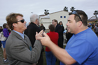 Paul Thackery (wearing sunglasses) and Jacob Mc Mann discuss their opposing views on the proposed alcohol ban during a rally in support of the ban in Mission Beach on Friday Janurary 4 2007.  Thackery supports the ban, McMann does not.