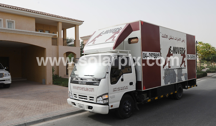 **ALL ROUND PICTURES FROM SOLARPIX.COM**.**WORLDWIDE SYNDICATION RIGHTS**.Dubai house prices fell by 24 per cent in the second quarter due to the economic slowdown in the country. Dubai, UAE. 11 August 2009..This pic: removal trucks in Arabian Ranches, Dubai, an area of Dubai largely populated by British Ex Pats..JOB REF: 9740 DBL     DATE: 11_08_2009.**MUST CREDIT SOLARPIX.COM OR DOUBLE FEE WILL BE CHARGED**.**MUST NOTIFY SOLARPIX OF ONLINE USAGE**.**CALL US ON: +34 952 811 768 or LOW RATE FROM UK 0844 617 7637**