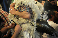 "A ""Joaldun"" group get ready on January 27, 2014 at the village of Ituren, Basque Country. Joaldun groups perform an ancient traditional carnival at the villages of Ituren and Zubieta during two days, carrying sheep furs and big cowbells in their backs and making sound them in order to wake up the earth, to ask for a good new year, a good harvest and also to keep away the bad spirits. (Ander Gillenea / Bostok Photo)"