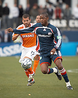 Houston Dynamo forward Alejandro Moreno (15) chases New England Revolution defender Avery John (4).  The Houston Dynamo win MLS Cup 2006 over the New England Revolution after playing to a 1-1 tie during regulation and extra time at Pizza Hut Park in Frisco, TX on November 12, 2006.