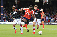 Pelly Ruddock of Luton Town breaks away from two defenders during the Sky Bet League 2 match between Luton Town and Doncaster Rovers at Kenilworth Road, Luton, England on 24 September 2016. Photo by Liam Smith.