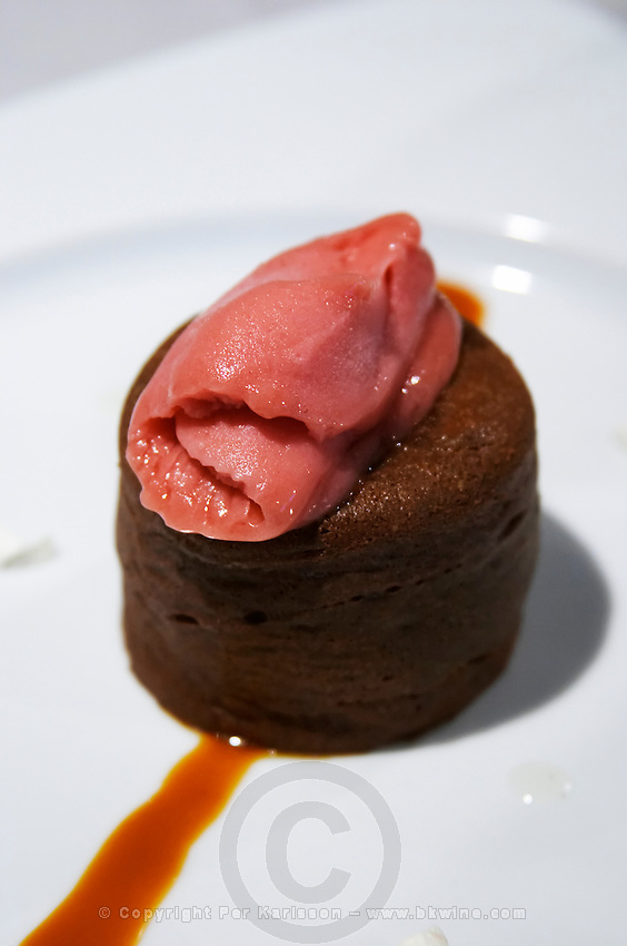 A chocolate fondant with icecream. Restaurant Cal Blay, Sant Sadurni d'Anoia, Catalonia, Spain.