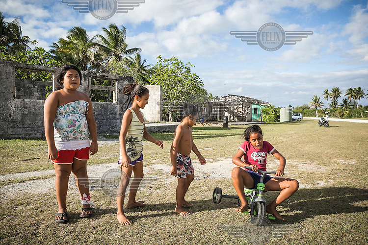 Tuvaluan children play in Vaiea village, Niue. Up to 100 Tuvaluans came across the Pacific to Niue. Many of them call themselves 'climate change refugees'. Overcrowding and threats causing by climate change have become a major push factor for Tuvaluans. Many Tuvaluans, who have settled in Niue, consider the resettlement program successful and there has been dialogue on the possibility of settling more Tuvaluan refugees in Niue, which has a declining population.