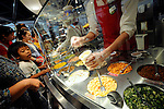 Visitors order toppings for their own original cup noodle at the My Cup Noodle Factory inside the Momofuku Ando Instant Ramen Museum in Osaka, Japan on 20 October 2008. Ingredients on offer include cheddar cheese, garlic chips and dried shrimp..