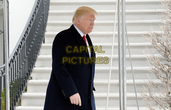 United States President Donald J. Trump walks on the South Lawn of the White House toward Marine One as he departs the White House on March 15, 2017 in Washington, DC.  The President will attend events in Michigan and Tennessee before returning to the White House this evening. <br /> CAP/MPI/CNP/RS<br /> &copy;RS/CNP/MPI/Capital Pictures