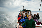 ALASKA, Homer, tourists take a ride on the Danny J boat from the Homer Spit to Halibut Cove