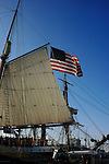 An  American flag flies on the  sail boat in San Diego Marina California.