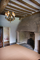 Typical features of Tudor architecture, such as the dark oak beams and massive stone fireplace, have remained relatively unaltered down the centuries