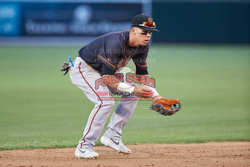AZL Giants Black shortstop Dilan Rosario (18) fields a ground ball during an Arizona League game against the AZL Athletics Gold on July 12, 2019 at Hohokam Stadium in Mesa, Arizona. The AZL Giants Black defeated the AZL Athletics Gold 9-7. (Zachary Lucy/Four Seam Images)