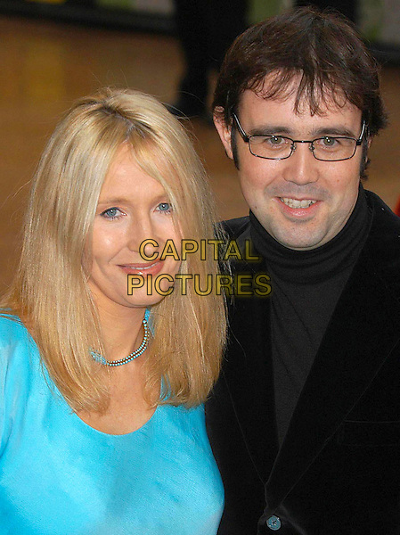 "JK ROWLING & husband, NEIL MURRAY.""Harry Potter and the Chamber of Secrets"".world premiere at Odeon cinema, Leicester Square, London, England, 3rd November 2002..portrait headshot married wife turquoise.Ref: PL.www.capitalpictures.com.sales@capitalpictures.com.©Phil Loftus/Capital Pictures."
