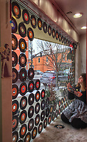 45-rpm records being used to decorate the front window at Cinda Lou Shop in Uptown Westerville.