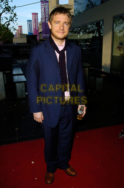 MARTIN FREEMAN .Attends the Cobravision Awards, BFI Southbank, .London, England, June 4th 2007..full length blue and red polka dot scarf pinstripe suit jacket bottle of beer.CAP/CAN.©Can Nguyen/Capital Pictures