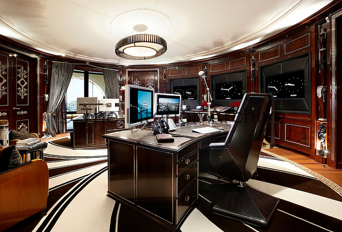 luxurious home office. Luxurious Home Office With Round Wood Panelled Walls Housing Oversize Clocks. Two Curved Desks Sit A