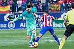 Leo Messi of Futbol Club Barcelona competes for the ball with  Angel Correa of Atletico de Madrid during the match of Spanish La Liga between Atletico de Madrid and Futbol Club Barcelona at Vicente Calderon Stadium in Madrid, Spain. February 26, 2017. (Rodrigo Jimenez / ALTERPHOTOS)