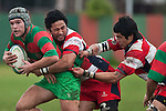 Mathew Hamilton gets wrapped up by Raymond Isara & Jamie Clark-Gilbert. Counties Manukau Premier Club Rugby game between Waiuku & Karaka played at Waiuku on Saturday July 4th 2009. Waiuku won the game 22 - 7.
