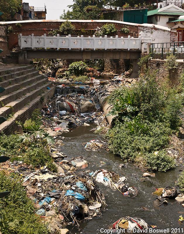 Trash pollutes a waterway in Kathmandu, Nepal.