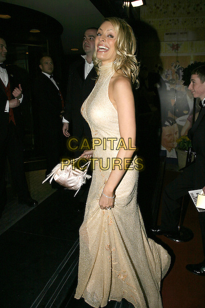 TESS DALY .Leaving the After Party for the Pioneer British Academy Television Awards (TV BAFTA's), Grosvenor House Hotel, .London, April 17th 2005..full length daley long cream gold dress bag sheer neck funny .Ref: AH.www.capitalpictures.com.sales@capitalpictures.com.©Adam Houghton/Capital Pictures.