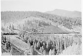 Full-length view of D&amp;RGW three-engine train of loaded gondolas ascending Marshall Pass at Shawano siding.<br /> D&amp;RGW  Shawano, CO  Taken by Kindig, Richard H. - 9/4/1939