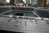 On the 10th anniversary of the September 11th attacks, flowers at the South Memorial Pool at opening day of the September 11th Memorial at the World Trade Center site in New York, New York on Sunday, September 11, 2011..Credit: Jefferson Siegel / Pool via CNP